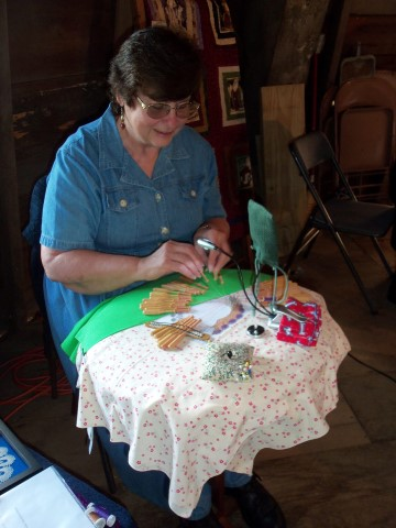 Susie was on the floor of the ole mill demonstrating Bobbin Lace with samples of both bobbin lace and tatting so people could see the difference.